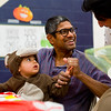 "Shankar Ayyalasomayajula wipes paint off his daughter Aanya's hand during the Halloween Carnival at the South Boulder Recreation Center on Friday.<br /> More photos:  <a href=""http://www.dailycamera.com"">http://www.dailycamera.com</a><br /> (Autumn Parry/Staff Photographer)<br /> October 28, 2016"