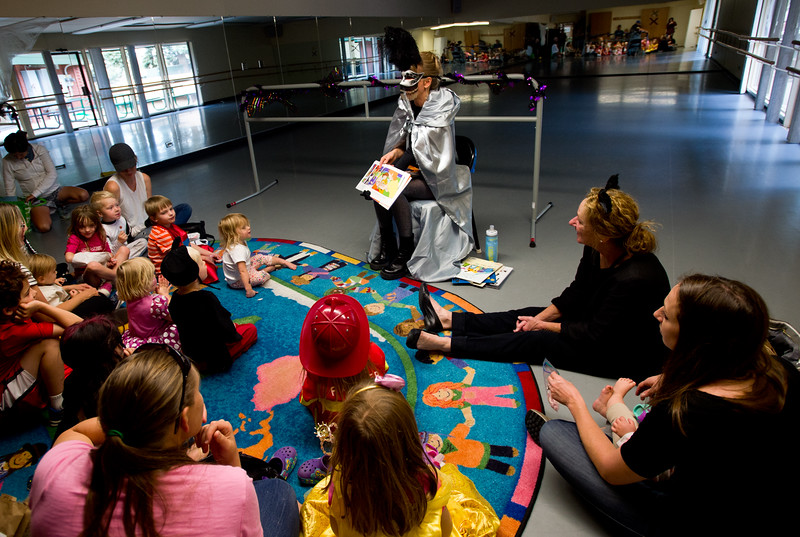 """Elisabeth Bowman reads to children during the Halloween Carnival at the South Boulder Recreation Center on Friday.<br /> More photos:  <a href=""""http://www.dailycamera.com"""">http://www.dailycamera.com</a><br /> (Autumn Parry/Staff Photographer)<br /> October 28, 2016"""