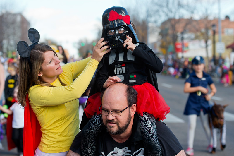 "Alyson Cook helps Jorie Perry secure her Darth Vader mask while on her dad's shoulders during the annual Halloween Parade and Trick or Treat Street in Longmont on Saturday. <br /> More photos:  <a href=""http://www.dailycamera.com"">http://www.dailycamera.com</a><br /> (Autumn Parry/Staff Photographer)<br /> October 29, 2016"