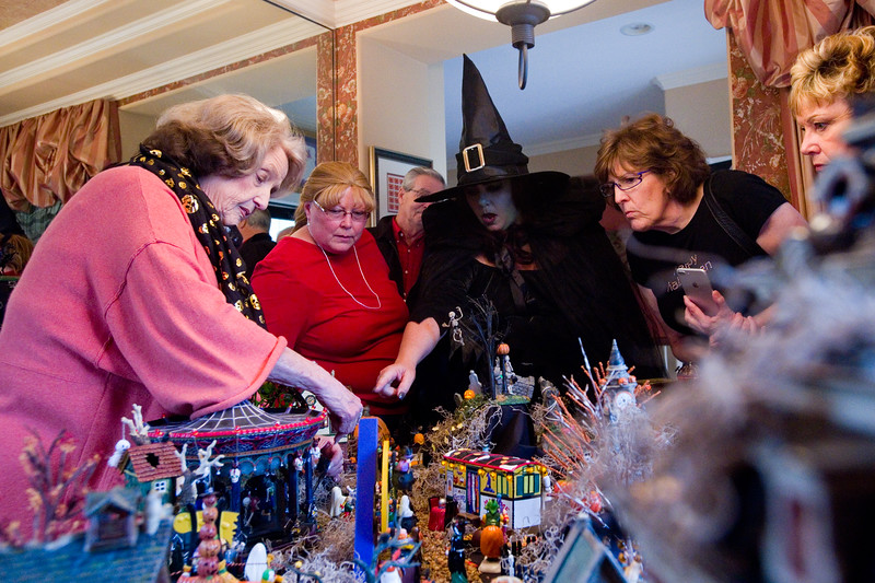 "Frannie Follick-Hood (left) talks about her Halloween village with Kathy Robey (center) and Wendy Kling in Longmont on Sunday. The set up includes a mortuary, blood bank and train station among many characters she has collected over the years. <br /> More photos:  <a href=""http://www.dailycamera.com"">http://www.dailycamera.com</a><br /> (Autumn Parry/Staff Photographer)<br /> October 30, 2016"