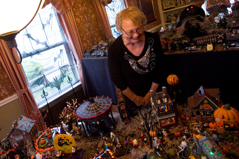"""Nancy George admires a Halloween village made by Frannie Follick-Hood at her home in Longmont on Sunday. The set up includes a mortuary, blood bank and train station among many characters she has collected over the years. <br /> More photos:  <a href=""""http://www.dailycamera.com"""">http://www.dailycamera.com</a><br /> (Autumn Parry/Staff Photographer)<br /> October 30, 2016"""