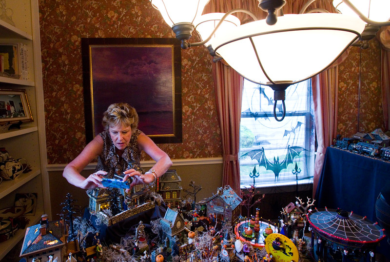 """Kathy Munoff takes a photo of a Halloween village made by Frannie Follick-Hood at her home in Longmont on Sunday.<br /> More photos:  <a href=""""http://www.dailycamera.com"""">http://www.dailycamera.com</a><br /> (Autumn Parry/Staff Photographer)<br /> October 30, 2016"""
