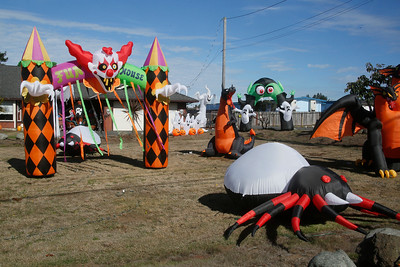 Inflatable characters and structures stand on two adjacent properties on Herrick Avenue not far from Highway 101 on Friday. (Shaun Walker -- The Times-Standard)