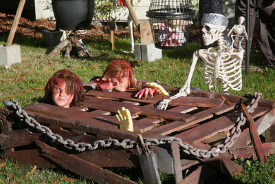 Trapped and wounded mannequin bodies and a pirate skeleton and that of a parrot sit in a yard display on Harrison Avenue near Cherry Court in Eureka on Friday. (Shaun Walker -- The Times-Standard)