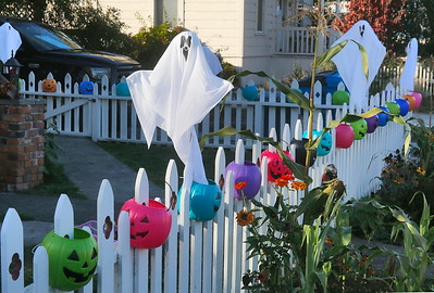 Ghosts and a colorful array of plastic jack-o-lanterns decorate a yard on McFarlan Street near 15th in Eureka on Friday. (Shaun Walker -- The Times-Standard)