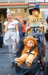 "Roam Todero, 19 months, and parents Johanna and Frank  walk down a closed street for Halloween on the Plaza on Wednesday night. The event also featured ""Thriller"" dances, fire trucks, the Marching Lumberjacks, music, and a carved pumpkin contest. (Shaun Walker -- The Times-Standard)"