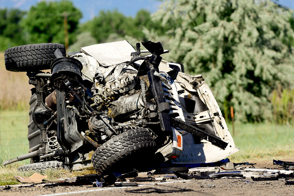 . Erie Police investigate a head-on crash between a Jeep and a pickup truck on Colo. 52 on Monday. Colo. 52 is closed between County Road 1 and County Road 3 as the investigation continues. More photos: timescall.com. Matthew Jonas/Staff Photographer June 19,  2017