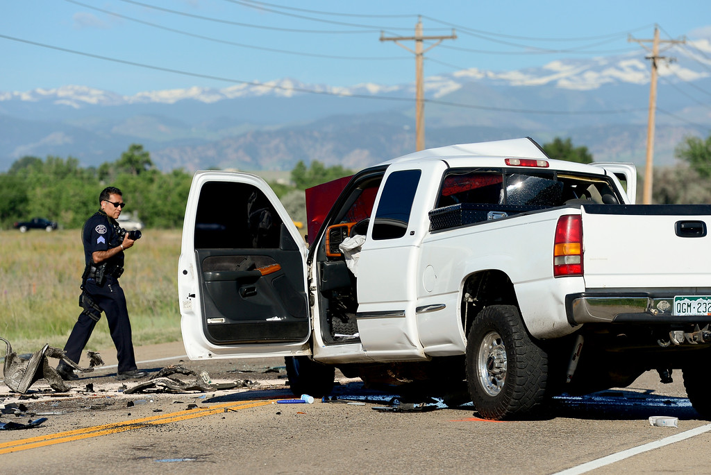 . Erie Police investigate a head-on crash between a Jeep and a pickup truck on Colo. 52 on Monday. More photos: timescall.com. Matthew Jonas/Staff Photographer June 19,  2017