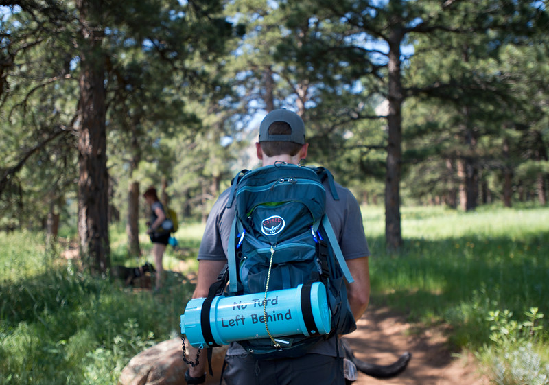 "Stephen Hillen, co-founder of Hike Doggie, carries a waste container during a hike with Kath Allen at Chautauqua Park on Friday. <br /> More photos:  <a href=""http://www.dailycamera.com"">http://www.dailycamera.com</a><br /> (Autumn Parry/Staff Photographer)<br /> June 17, 2016"