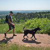 """Stephen Hillen, co-founder of Hike Doggie, hikes with Henry, a black lab, at Chautauqua Park on Friday. Hike Doggie, the new Golden-based dog hiking service, has expanded to Boulder.<br /> More photos:  <a href=""""http://www.dailycamera.com"""">http://www.dailycamera.com</a><br /> (Autumn Parry/Staff Photographer)<br /> June 17, 2016"""