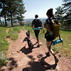 """Stephen Hillen and Kath Allen, co-founders of Hike Doggie, walk with Henry and LuLu along the trail at Chautauqua Park on Friday. Hike Doggie, the new Golden-based dog hiking service, has expanded to Boulder.<br /> More photos:  <a href=""""http://www.dailycamera.com"""">http://www.dailycamera.com</a><br /> (Autumn Parry/Staff Photographer)<br /> June 17, 2016"""