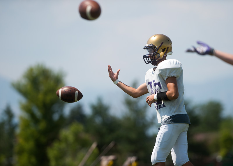 """Players participate in a drill during football practice at Holy Family High School in Broomfield on Friday.<br /> More photos:  <a href=""""http://www.BoCoPreps.com"""">http://www.BoCoPreps.com</a><br /> (Autumn Parry/Staff Photographer)<br /> August 19, 2016"""