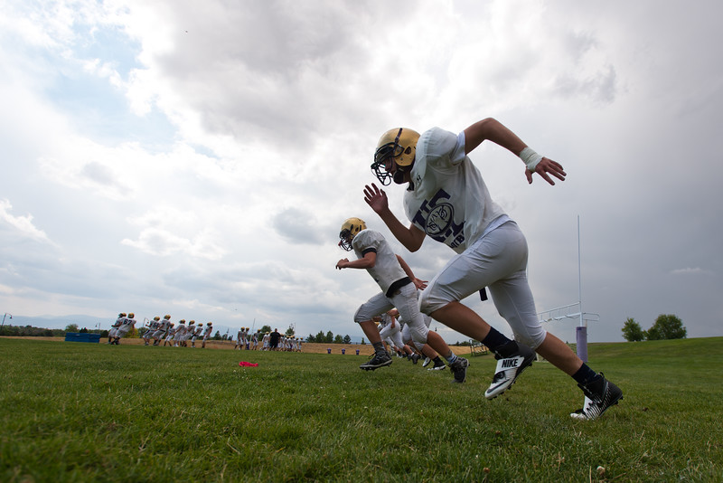 "Jack Thomas, a left tackle, participates in a running drill during football practice at Holy Family High School in Broomfield on Friday.<br /> More photos:  <a href=""http://www.BoCoPreps.com"">http://www.BoCoPreps.com</a><br /> (Autumn Parry/Staff Photographer)<br /> August 19, 2016"