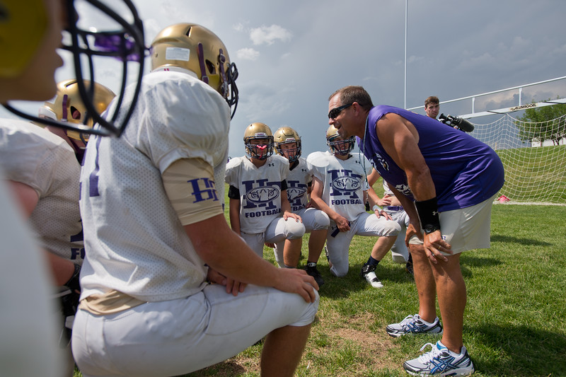 "Coach Matt Brothers talks with the team after football practice at Holy Family High School in Broomfield on Friday.<br /> More photos:  <a href=""http://www.BoCoPreps.com"">http://www.BoCoPreps.com</a><br /> (Autumn Parry/Staff Photographer)<br /> August 19, 2016"