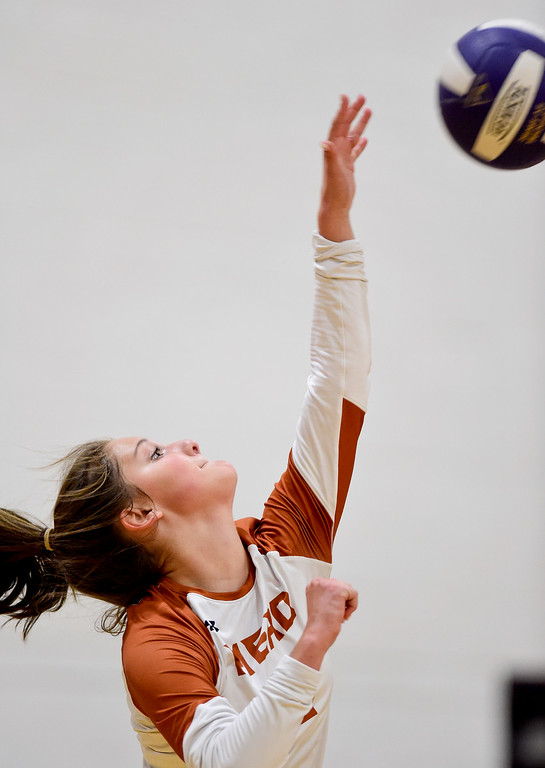 . BROOMFIELD, CO - OCTOBER 9:Mead High School\'s Hailee Martinez (No. 3) serves to Holy Family High School in Broomfield on Oct. 9, 2018. (Photo by Matthew Jonas/Staff Photographer)