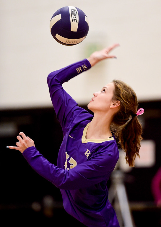 . BROOMFIELD, CO - OCTOBER 9:Holy Family High School\'s Madison Forss (No. 13) serves the ball to Mead High School in Broomfield on Oct. 9, 2018. (Photo by Matthew Jonas/Staff Photographer)