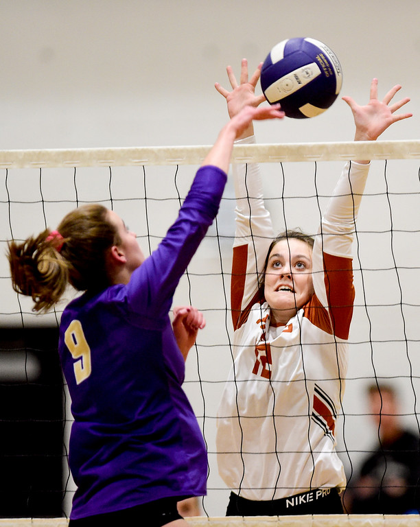 . BROOMFIELD, CO - OCTOBER 9:Mead High School\'s Brenley Bruxvoort (No. 12) tries to block a spike from Holy Family High School\'s Abby Sawyer (No. 9) in Broomfield on Oct. 9, 2018. (Photo by Matthew Jonas/Staff Photographer)