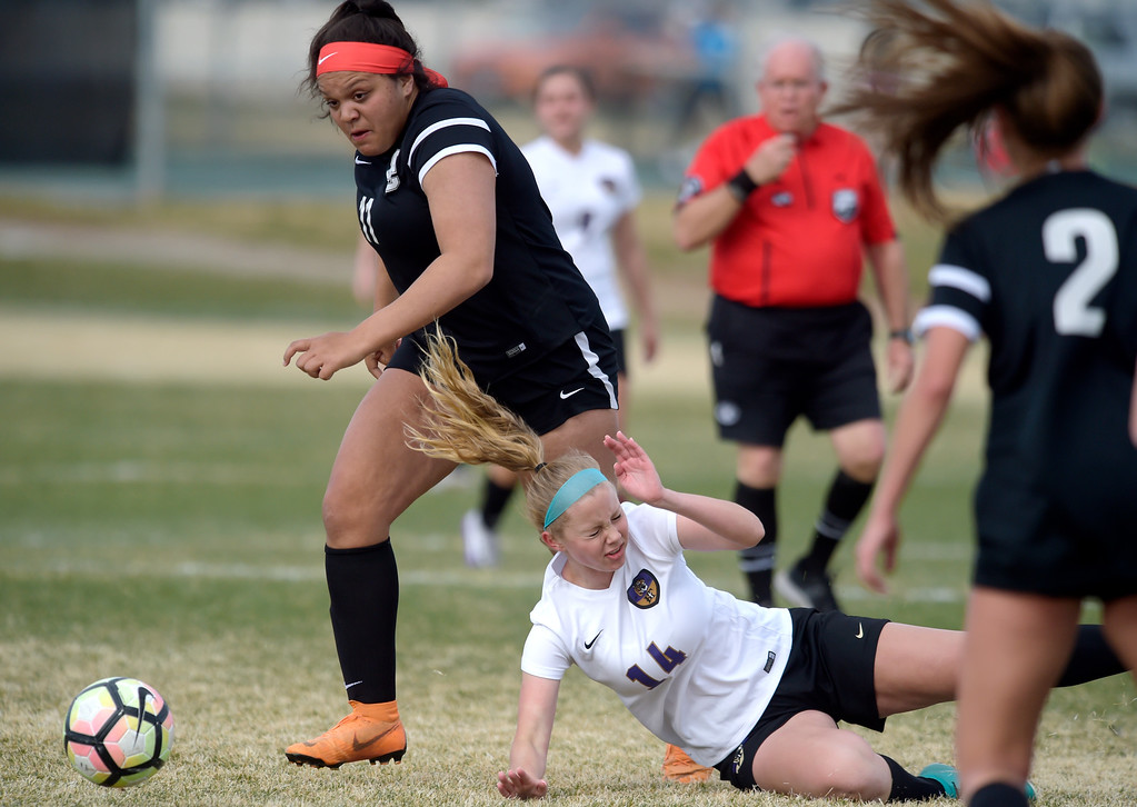 . LONGMONT, CO - APRIL 1: Holy Family\'s Sarah Uhler goes to the ground next to Silver Creek\'s Greta Goldsberry in the first half at Silver Creek High School April  1, 2019. To view more photos visit bocopreps.com. (Photo by Lewis Geyer/Staff Photographer)