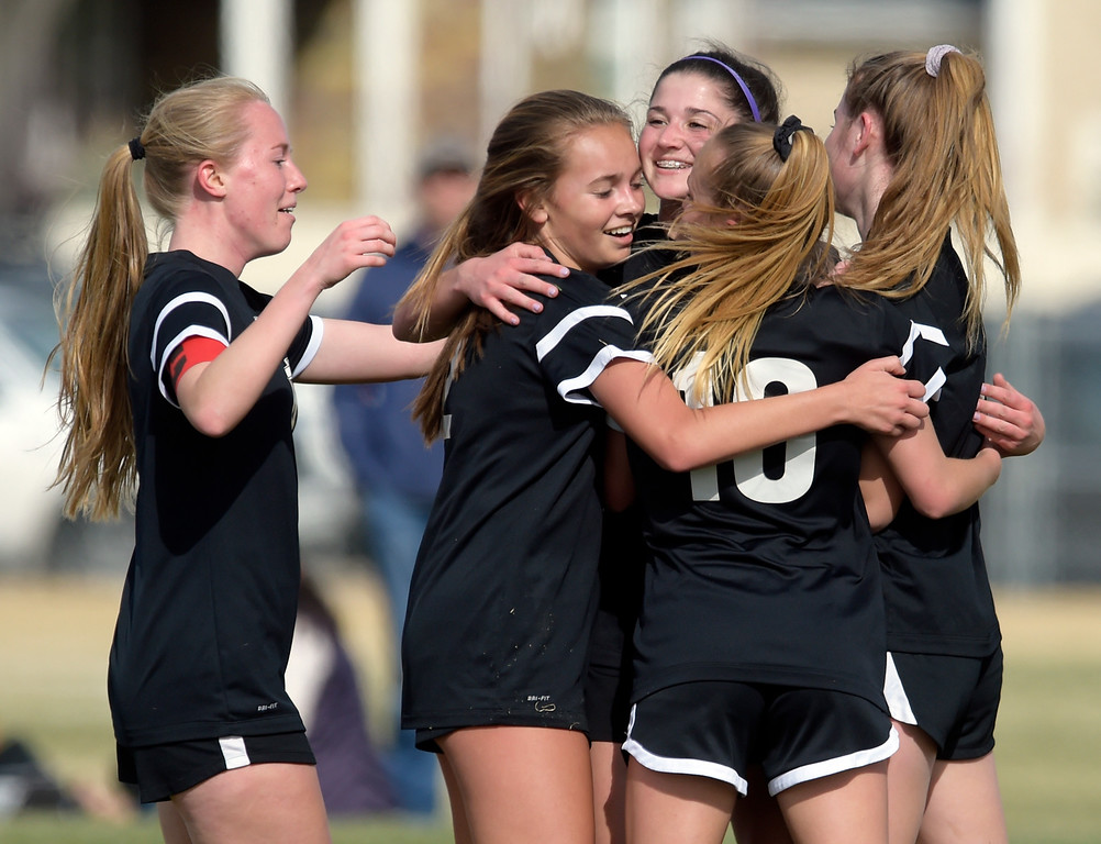 . LONGMONT, CO - APRIL 1: Silver Creek\'s Alexa Karsel is surrounded by teammates after scoring a goal in the first half against Holy Family at Silver Creek High School April  1, 2019. To view more photos visit bocopreps.com. (Photo by Lewis Geyer/Staff Photographer)