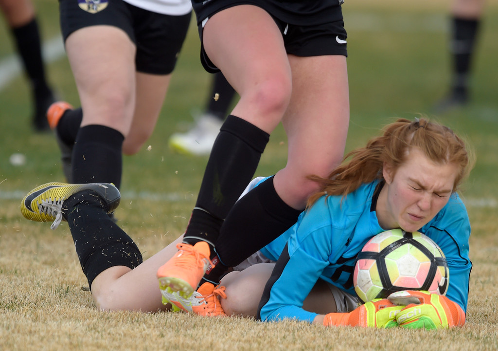 . LONGMONT, CO - APRIL 1: Holy Family goalie Sally Napierkowski grabs a loose ball in the first half against Silver Creek at Silver Creek High School April  1, 2019. To view more photos visit bocopreps.com. (Photo by Lewis Geyer/Staff Photographer)