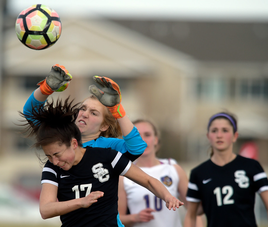 . LONGMONT, CO - APRIL 1: Holy Family goalie Sally Napierkowski knocks the ball away from Silver Creek\'s Annelise Vandiver on a Silver Creek corner kick in the first half at Silver Creek High School April  1, 2019. To view more photos visit bocopreps.com. (Photo by Lewis Geyer/Staff Photographer)