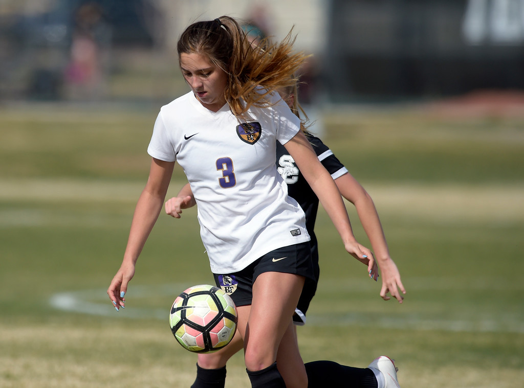 . LONGMONT, CO - APRIL 1: Holy Family\'s Ashley Ward moves the ball in front of Silver Creek\'s Anika Kassenbrock in the first half at Silver Creek High School April  1, 2019. To view more photos visit bocopreps.com. (Photo by Lewis Geyer/Staff Photographer)