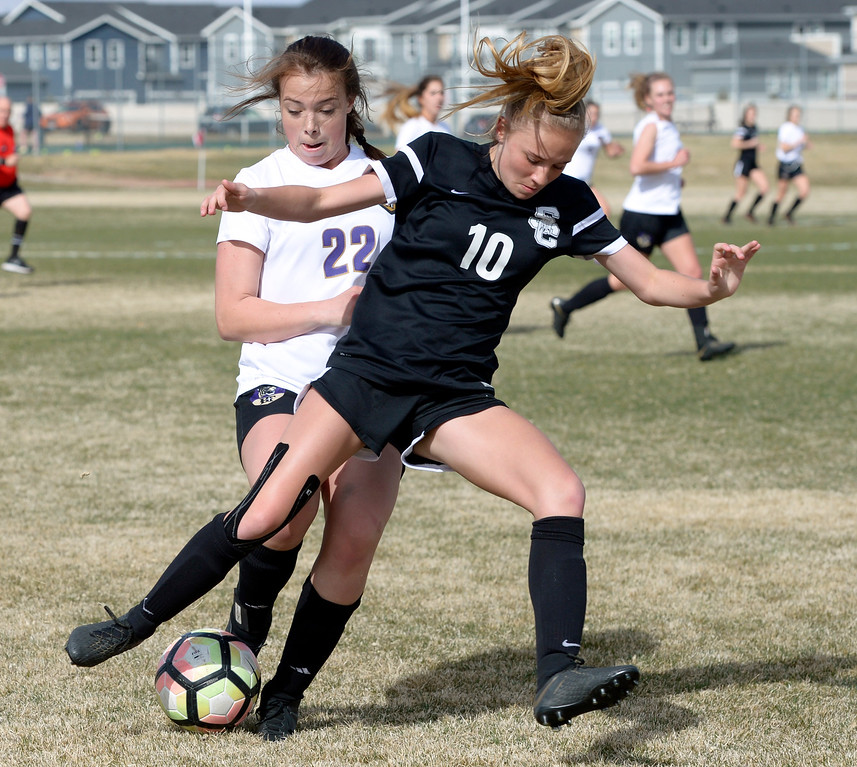 . LONGMONT, CO - APRIL 1: Silver Creek\'s Annika Kassenbrock and Holy Family\'s Ava Kusak battle for the ball in the first half at Silver Creek High School April  1, 2019. To view more photos visit bocopreps.com. (Photo by Lewis Geyer/Staff Photographer)