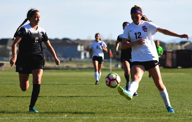 Silver Creek's leading scorer Alexa Karsel flicks a pass into the box during the game between No. 2 Silver Creek and No. 10 Holy Family on Friday, April 27, at Silver Creek High School in Longmont.