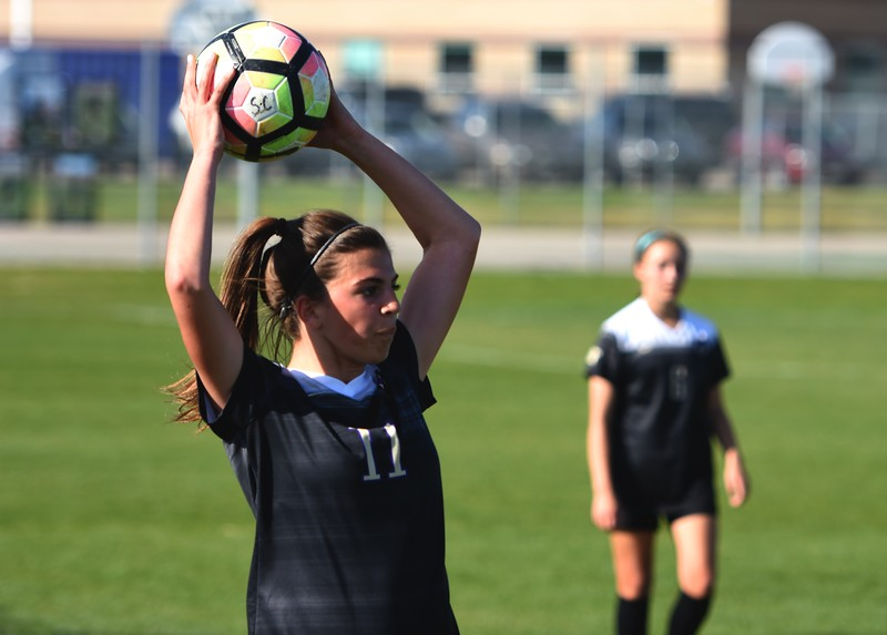 Holy Family's Jules Geneser readies a throw in during the game between No. 2 Silver Creek and No. 10 Holy Family on Friday, April 27, at Silver Creek High School in Longmont.