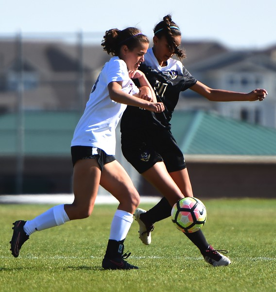 Holy Family's Daniella Hren (right) fends off a defender during the game between No. 2 Silver Creek and No. 10 Holy Family on Friday, April 27, at Silver Creek High School in Longmont.