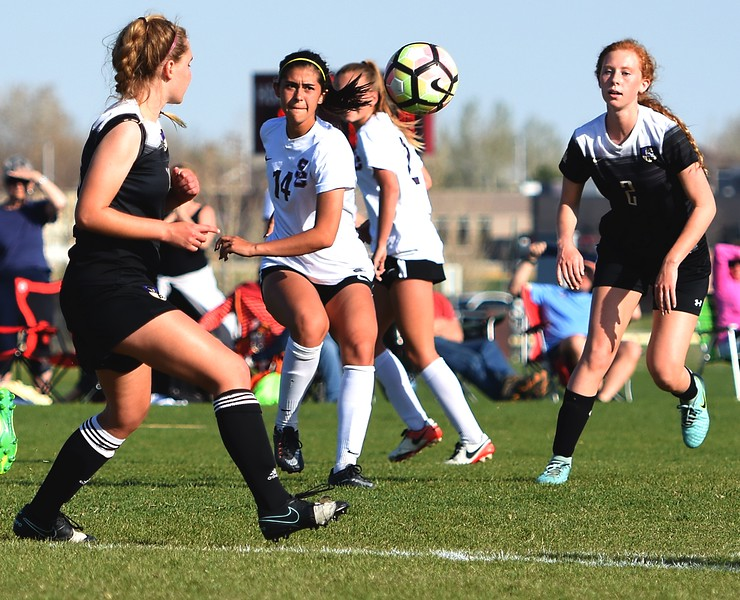 Silver Creek's Teresa McGlothlin takes a free kick during the game between No. 2 Silver Creek and No. 10 Holy Family on Friday, April 27, at Silver Creek High School in Longmont.