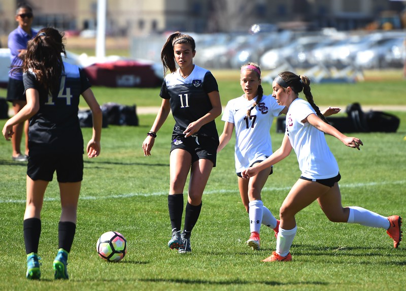 Holy Family's Jules Geneser passes to a teammate during the game between No. 2 Silver Creek and No. 10 Holy Family on Friday, April 27, at Silver Creek High School in Longmont.