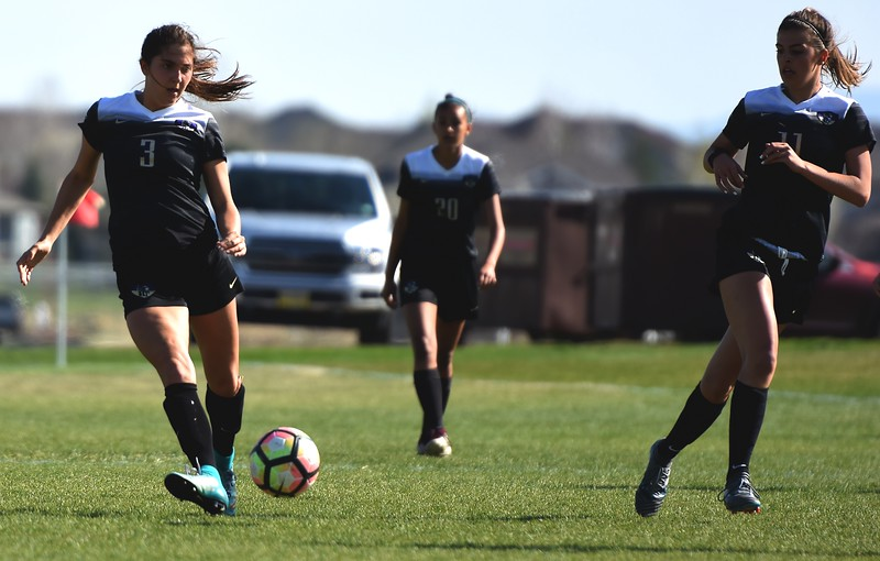 Holy Family's Ashley Ward makes a pass during the game between No. 2 Silver Creek and No. 10 Holy Family on Friday, April 27, at Silver Creek High School in Longmont.