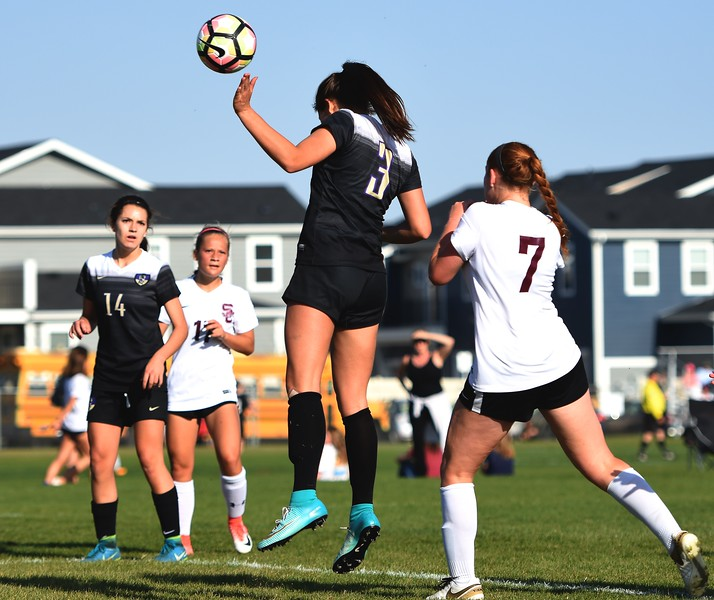 Holy Family's Ashley Ward leaps for a header during the game between No. 2 Silver Creek and No. 10 Holy Family on Friday, April 27, at Silver Creek High School in Longmont.