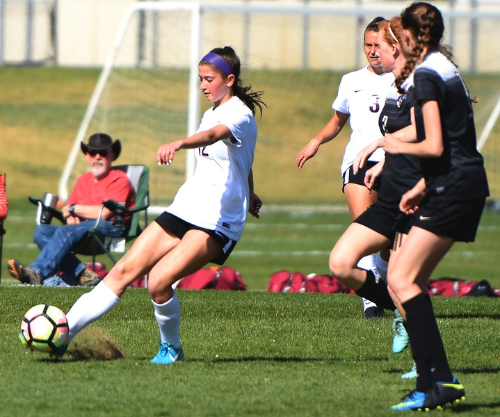 Alexa Karsel plays a long pass during the game between No. 2 Silver Creek and No. 10 Holy Family on Friday, April 27, at Silver Creek High School in Longmont.