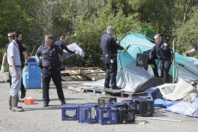 Shaun Walker — The Times-Standard  Officers clear out an abandoned tent.