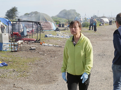 Shaun Walker — The Times-Standard  Betty Kwan Chinn walks around the campsites.