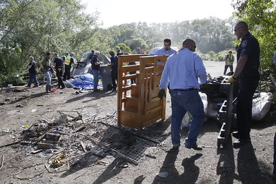 Shaun Walker — The Times-Standard  County jail inmates help dispose of abandoned items.