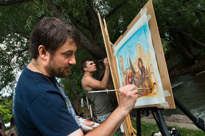"Artists Joshua Morriston (left) and Derek Carpenter, with Art of One, paint near the creek during the Hometown Fair in Boulder's Central Park on Sunday.<br /> More photos:  <a href=""http://www.dailycamera.com"">http://www.dailycamera.com</a><br /> (Autumn Parry/Staff Photographer)<br /> September 4, 2016"