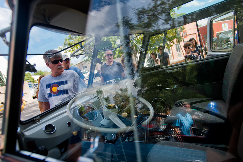 "Andy Holland looks at a 1965 volkswagen microbus, during the car show at the Hometown Fair in Boulder's Central Park on Sunday. <br /> More photos:  <a href=""http://www.dailycamera.com"">http://www.dailycamera.com</a><br /> (Autumn Parry/Staff Photographer)<br /> September 4, 2016"