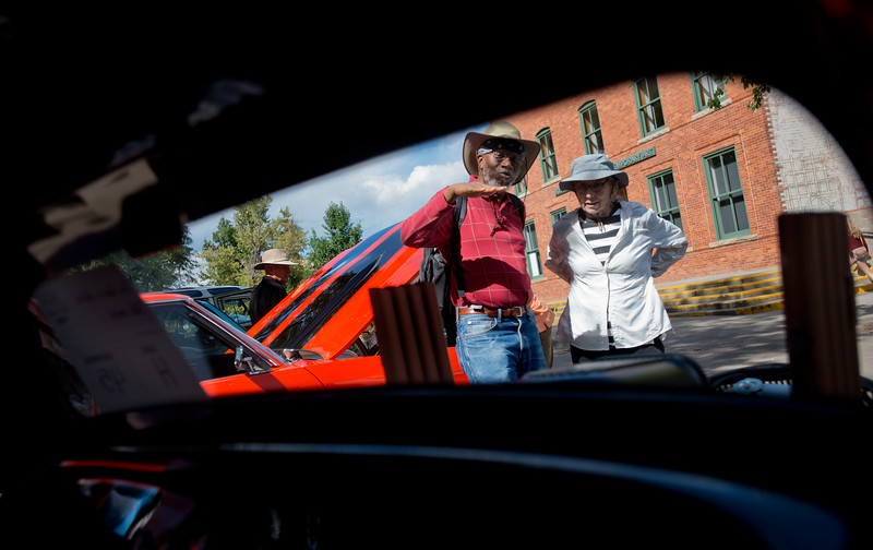 "Passersby, who asked not to be named, look at older vehicles during the car show at the Hometown Fair in Boulder's Central Park on Sunday. <br /> More photos:  <a href=""http://www.dailycamera.com"">http://www.dailycamera.com</a><br /> (Autumn Parry/Staff Photographer)<br /> September 4, 2016"