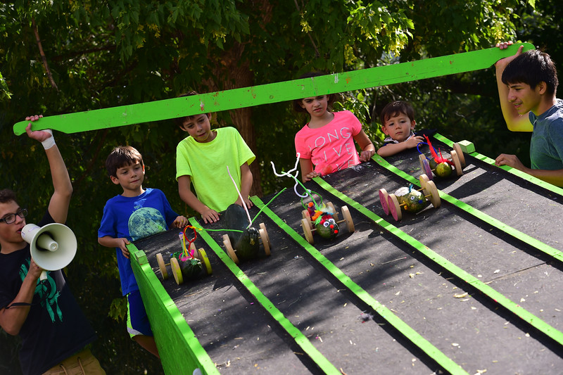 "Joaquin , 7, (left) and his brother Mateo, 10, who requested not to share their last names, race their zucchini cars during the Hometown Fair in Boulder's Central Park on Sunday. <br /> More photos:  <a href=""http://www.dailycamera.com"">http://www.dailycamera.com</a><br /> (Autumn Parry/Staff Photographer)<br /> September 4, 2016"