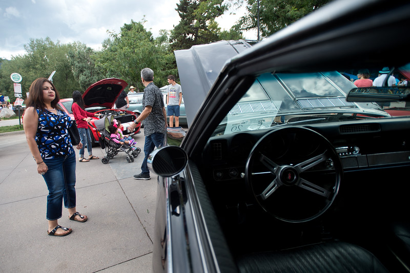 "Lucy Nuñez looks at a 1969 Oldsmobile during the car show at the Hometown Fair in Boulder's Central Park on Sunday.<br /> More photos:  <a href=""http://www.dailycamera.com"">http://www.dailycamera.com</a><br /> (Autumn Parry/Staff Photographer)<br /> September 4, 2016"