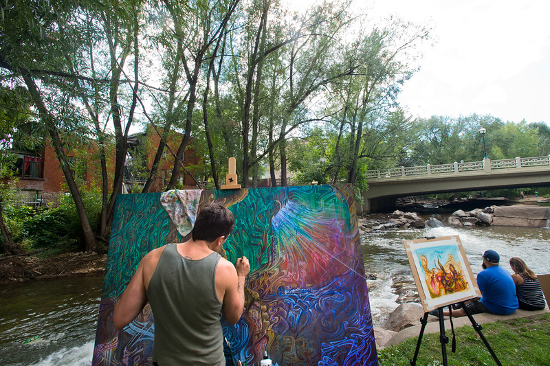 "Artist Derek Carpenter, with Art of One, paints near the creek during the Hometown Fair in Boulder's Central Park on Sunday.<br /> More photos:  <a href=""http://www.dailycamera.com"">http://www.dailycamera.com</a><br /> (Autumn Parry/Staff Photographer)<br /> September 4, 2016"