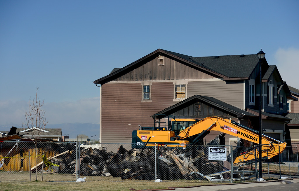 . A track hoe is seen parked next to the debris from a burned house on the 6300 Block of Twilight Avenue in Firestone on Wednesday. On Monday a house was destroyed by a fire killing two people inside and injuring two others. More photos: TimesCall.com. Matthew Jonas/Staff Photographer April 19,  2017