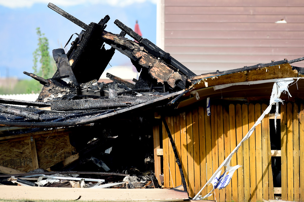 . Smoke still rises from burned pieces of a house that exploded in Firestone on Tuesday. More photos: TimesCall.com. Matthew Jonas/Staff Photographer April 18,  2017