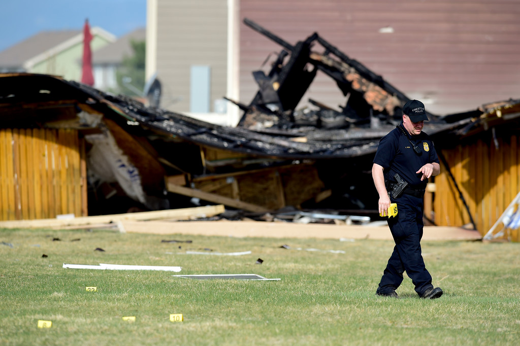 . An investigator with the Firestone Police places evidence markers on debris that came from a house on the 6300 block of Twilight Ave. that exploded on Monday afternoon. More photos: TimesCall.com. Matthew Jonas/Staff Photographer April 18,  2017