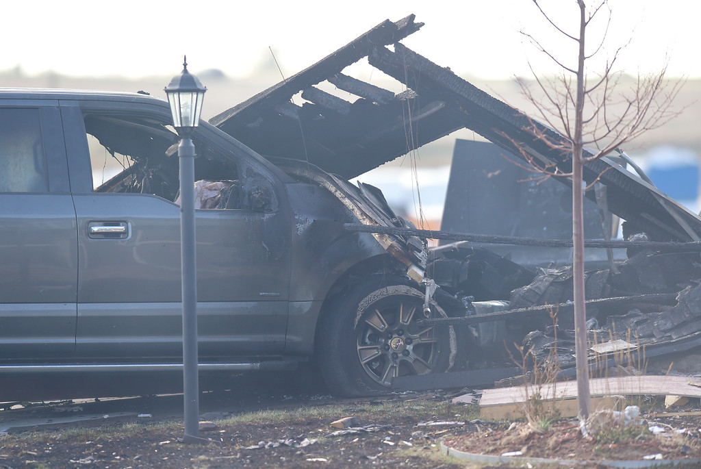 . A burned pickup truck and pieces of a house are seen in Firestone on Tuesday. More photos: TimesCall.com. Matthew Jonas/Staff Photographer April 18,  2017