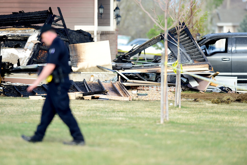 . An investigator with the Firestone Police places evidence markers on debris that came from a house on Tuesday. More photos: TimesCall.com. Matthew Jonas/Staff Photographer April 18,  2017