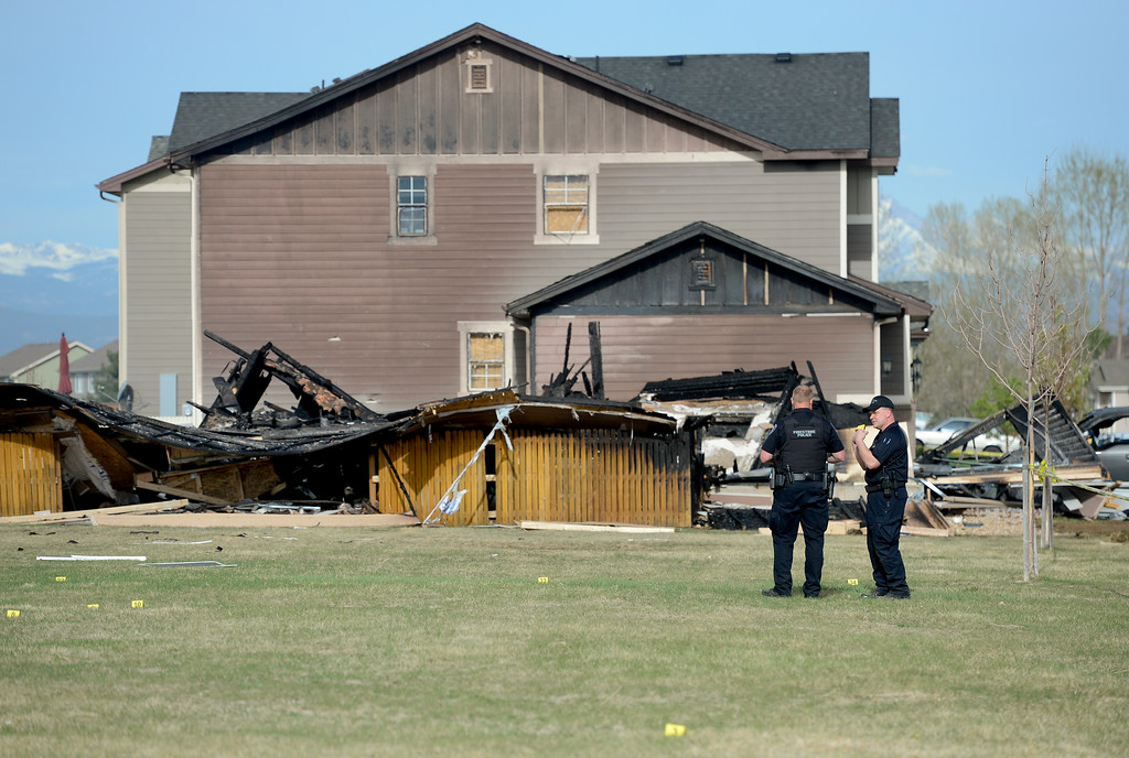 . Firestone Police officers are seen near debris that came from a house on Tuesday. More photos: TimesCall.com. Matthew Jonas/Staff Photographer April 18,  2017